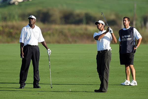 Vijay and Qass Singh on the second hole. They finished tied for sixth.