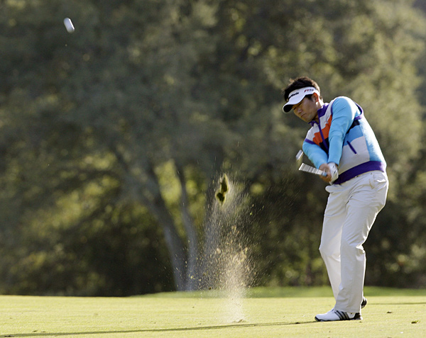 Y.E. Yang shot a seven-under 65 to build a two-shot lead.