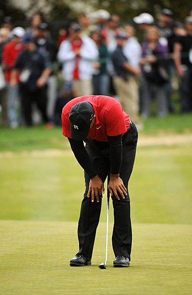 Woods made double-bogey on the par-5 13th hole to drop two shots back of McDowell.