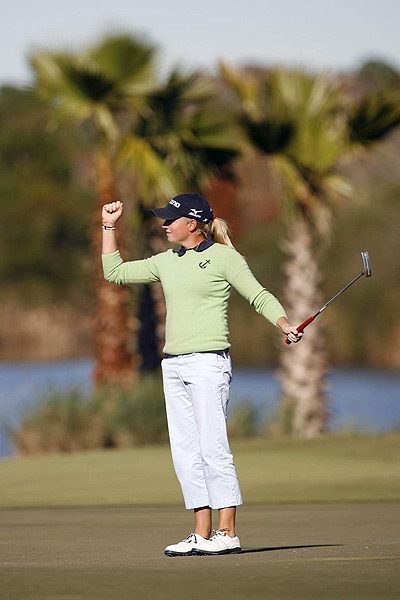Stacy Lewis earned her card and finished in first place at 18 under par.