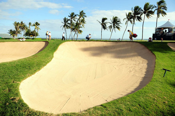 "Photographer: Robert Beck                                              ""Sometimes you have to be creative to convey the location and make the tournament look interesting. The 17th at                       the Sony Open has a green fronted by immense bunkers. As Jim Furyk misses a putt, my wide-angle lens captures                       the bunkers and palm trees in a way that creates a very dynamic and graphic scene and screams Hawaii."""