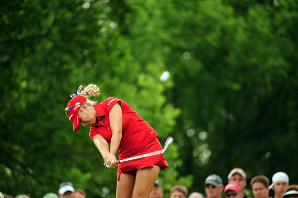 "Photographer: Fred Vuich                                              ""This spot at the U.S. Women's Open had nice, diffused                       light and a plain green background that made                       Natalie Gulbis and her red outfit jump out of the frame."""