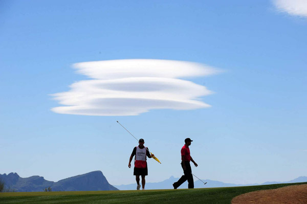 "Photographer: Robert Beck                                              ""Tiger Woods and Stevie Williams at the Match Play was                       no big deal, but I couldn't resist when they were joined                       by clouds that looked like a triple-decker alien spacecraft."""