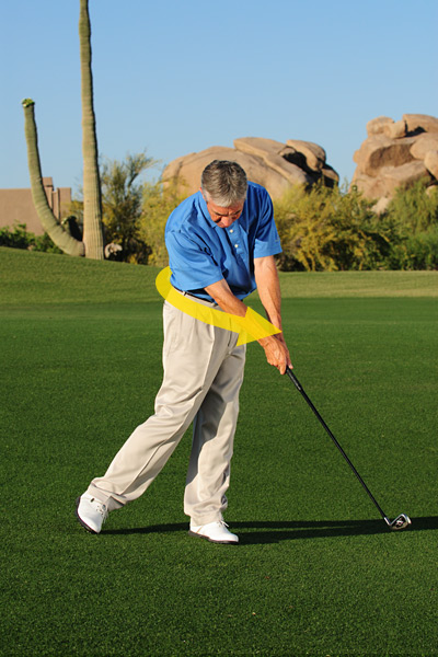 Step 3: Swing down the slope while turning your hips so that they're open to the target at impact. If you come down steep without pivoting your lower body, you'll jam the club into the ground.