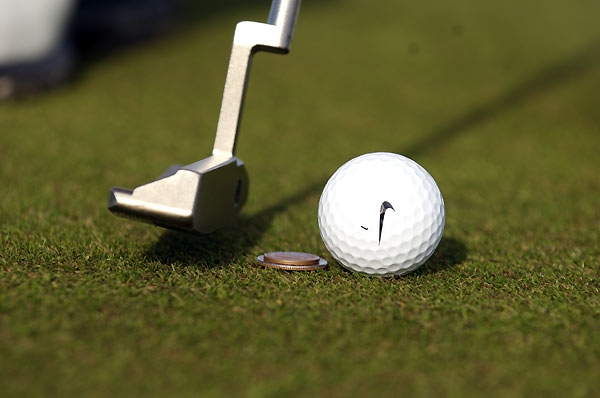 3. How to Make a Money Stroke                       GOLF Magazine Top 100 Teacher Tim Mahoney                       has a foolproof way to make your putts roll                       smoothly to the target, but                       it'll cost you — 35 cents. Stack a dime on top of a                       quarter directly behind the ball on the target line. Hover your putter over the coins at                       address and make your stroke. If your forward                       stroke is solid, you'll miss the coins. (Don't cheat                       by exaggerating a descending blow.) This drill                       produces a slightly descending stroke that bottoms                       out at the equator of the ball for an ultra-pure roll.                                              More tips from: Tim Mahoney | The Top 100