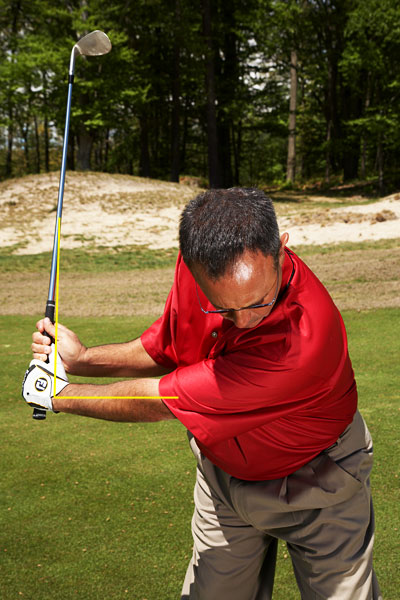 STEP 2: Backswing                       Hinge the club with your wrists, but otherwise keep your hands quiet. Keep in mind that this is a control shot—never make more than a three-quarter backswing. A 75 percent backswing with a 60-degree lob wedge rotated slightly open should give you about 50 yards of distance.