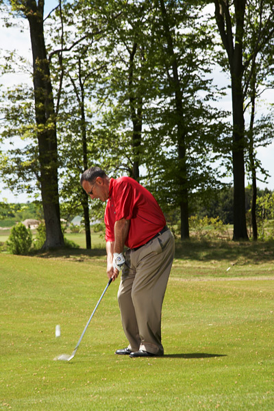STEP 3: Downswing                       Swing down with almost full force. The mistake most people make on this shot is easing up and leaving it short. A more aggressive swing will create an even higher ball flight and more spin so you can land the ball softly near tucked pins from short distances.