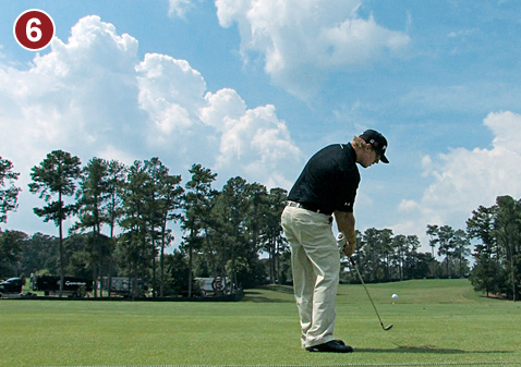 6. Don't confuse a fade with a lack of power. Mahan's impact position packs a ton of punch. Notice how much more open his hips are than his shoulders. Sequencing the downswing like this sends your swing speed off the charts.Body turns left while his chest stays down.