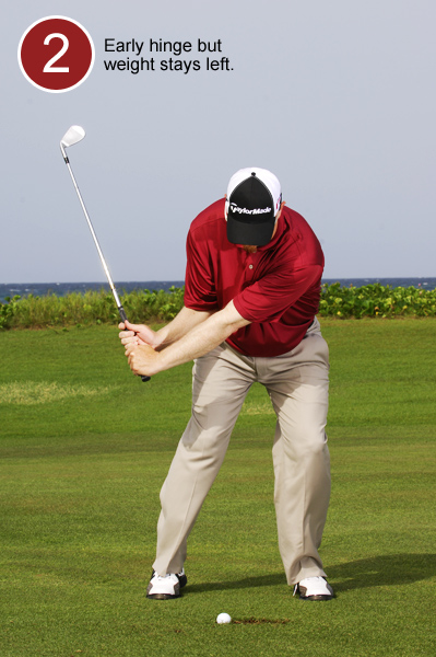 2. Hinge quickly on your backswing to set the clubhead higher than your hands and keep your weight over your left leg. This creates a steep downswing that will get the clubface to the equator of the ball.
