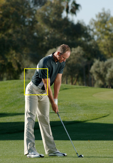 4. Bend from your hips, keeping your shoulder blades back and your spine straight, and set your club behind the ball.