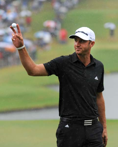 Dustin Johnson waves to the fans after finishing his third round on Saturday. Johnson took advantage of Stenson's back-nine misadventures to get within four shots of the lead.