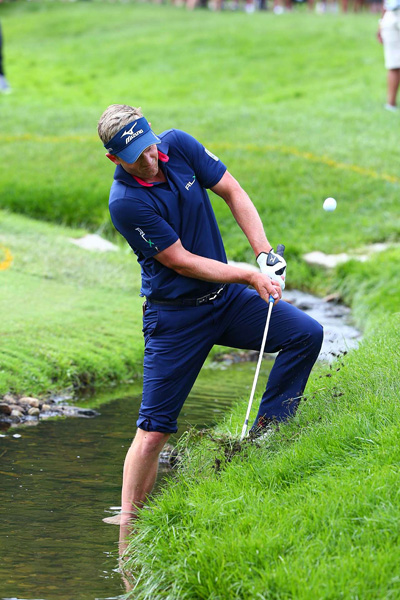 Luke Donald made a double bogey, five bogeys and a birdie on the front nine and finished tied for eighth.