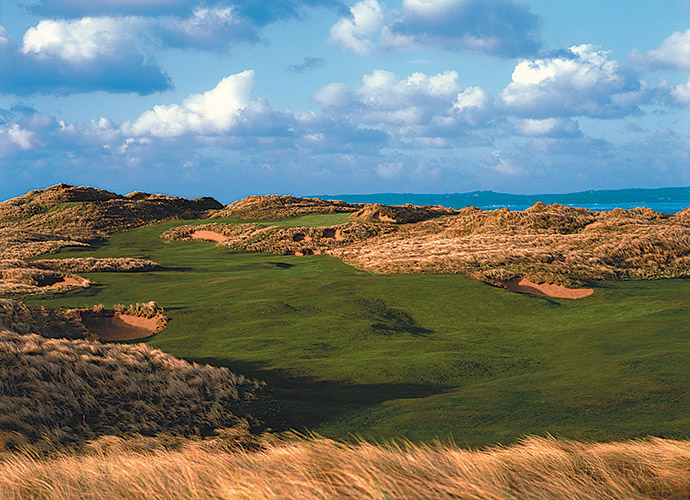 Trump International Golf Links & Hotel Ireland -- Doonbeg, Ireland -- No. 14: Par 3, 111 yards                       For pure grin-inducement, the tee shot at the par-4 6th might triumph at Doonbeg, thanks to its elevated tee above the beach, but for sheer audacity, my pick is this all-or-nothing, tiny par 3, shelved into the sandhills, its diagonal green backdropped by the Atlantic.