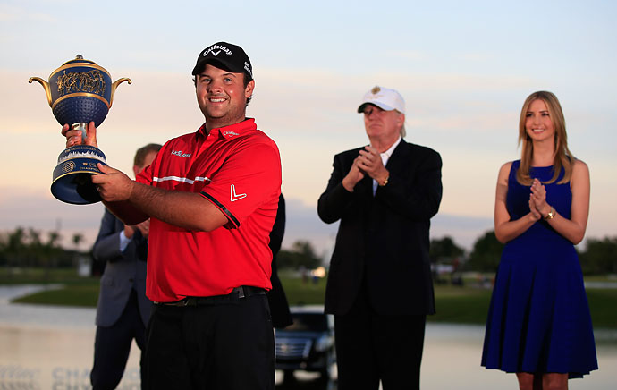 Patrick Reed celebrates with the Gene Sarazen Cup after his victory as Donald Trump and Ivanka Trump look on after final round of the Cadillac Championship.