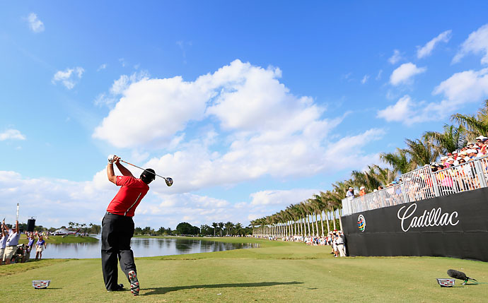 Patrick Reed watches his tee shot on the tenth hole during the final round of the World Golf Championships-Cadillac Championship at Trump National