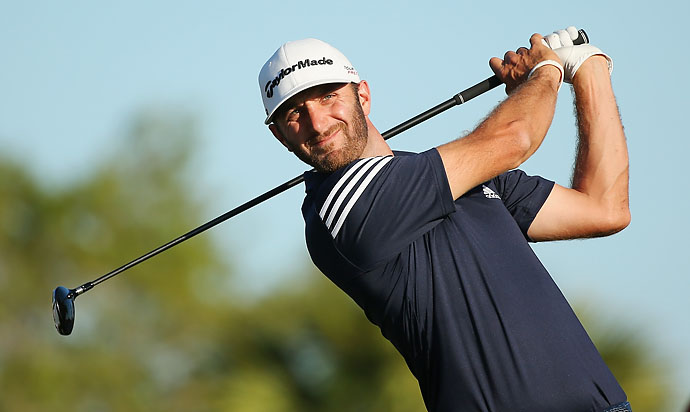 Dustin Johnson hits his tee shot on the 14th hole during the third round of the World Golf Championships-Cadillac Championship at Trump National Doral on Saturday.