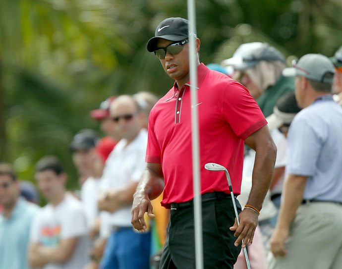 Tiger Woods examines the 7th green before he chips up during the final round of the WGC-Cadillac Championship at Trump National Doral on Sunday. Woods shot 78, his worst ever round at Doral and visibly struggled with a sore back.