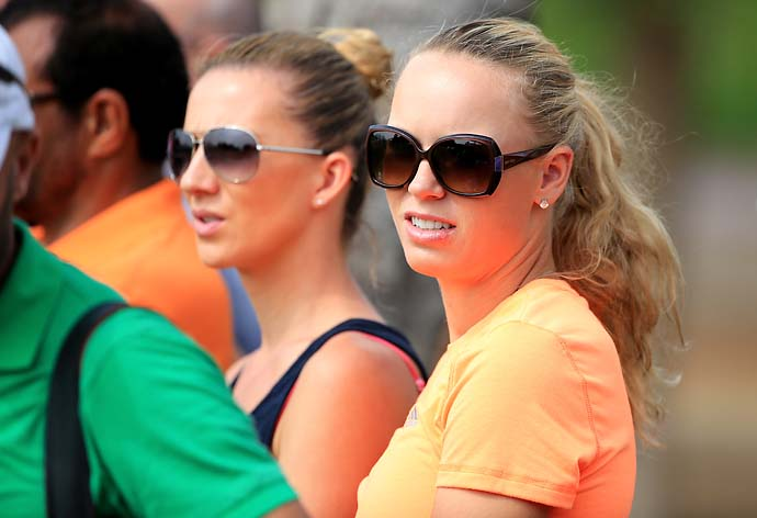 Caroline Wozniacki watches her fiance Rory McIlroy during the second round of the 2014 Omega Dubai Desert Classic.
