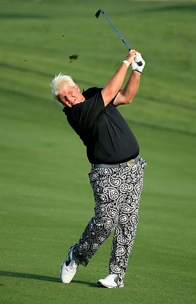 John Daly plays his second shot on the 10th hole during the second round of the 2014 Omega Dubai Desert Classic.