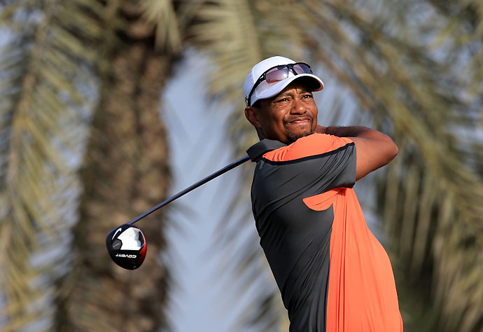 Tiger Woods plays his tee shot on the par 5, third hole during the third round of the 2014 Omega Dubai Desert Classic.