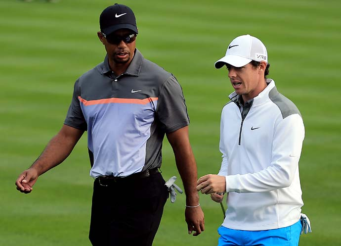Tiger Woods and Rory McIlroy during the first round of the Dubai Desert Classic golf tournament in Dubai, United Arab Emirates, Thursday, Jan. 30, 2014.