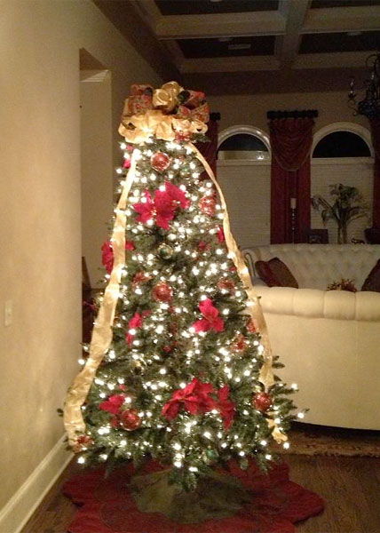 Jason Dufner put up the Christmas tree while his wife, Amanda, went to a football game.