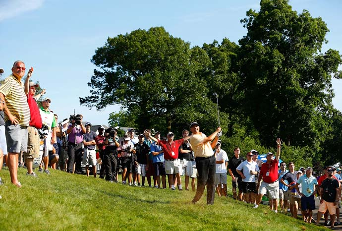 Ken Duke plays his second shot from the hillside on the 18th hole Sunday. Duke recently returned to using Bob Toski as his swing coach. Toski won the Travelers Championship in 1953. Toski was the first first-time winner in Hartford.