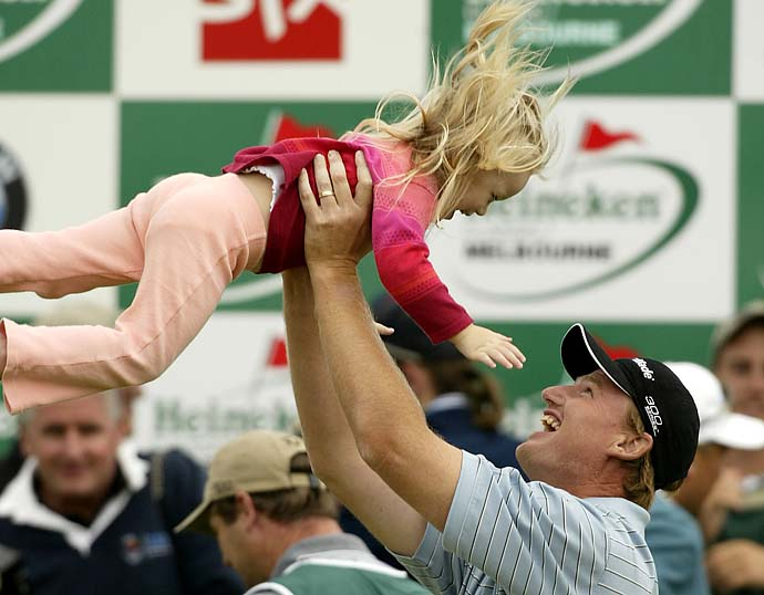 Ernie Els lifts his daughter Samantha after winning the Heineken Classic with a score of 17-under-par at the Royal Melbourne Golf Club, Melbourne, Australia, in February 2002.