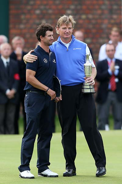New Open Champion Ernie Els hugs his good friend and runner-up Adam Scott after winning the 141st Open Championship at Royal Lytham & St. Annes Golf Club on July 22, 2012 in Lytham St Annes, England.