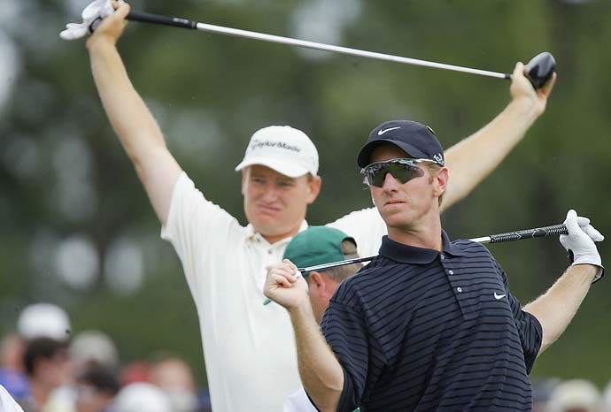 David Duval and Ernie Els stretch out on the first tee during the second day of the 2002 Masters Tournament from the Augusta National Golf Club, Augusta, Ga.