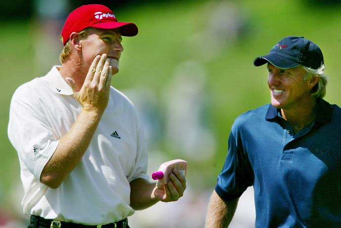Ernie Els puts on sunscreen as he waits to tee off with Greg Norman at Hazeltine National Golf Club in Chaska Minn., on Wednesday, Aug. 14, 2002, during practice for the PGA Championship.