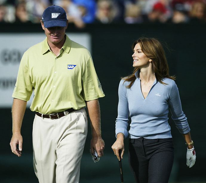 Ernie Els walks with model Cindy Crawford during a promotional event following the third round of the Omega European Masters on September 6, 2003 at Crans sur Sierre Golf Club in Crans Montana, Switzerland.