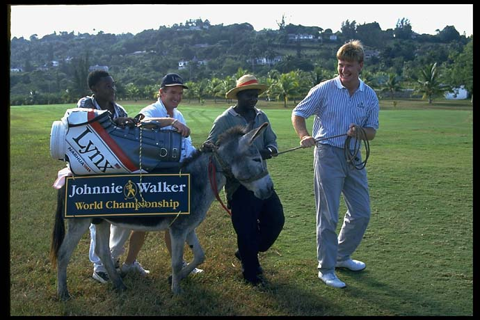 Ernie Els leads a donkey carrying golf clubs, and wearing at tournament sign at the Johnnie Walker Classic in Thailand in December 1994.