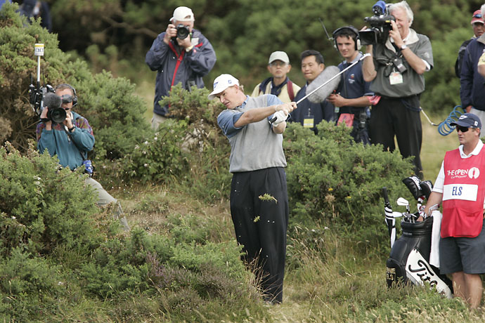 Ernie Els hits a ball embedded in a bush during the 2004 British Open at Royal Troon.