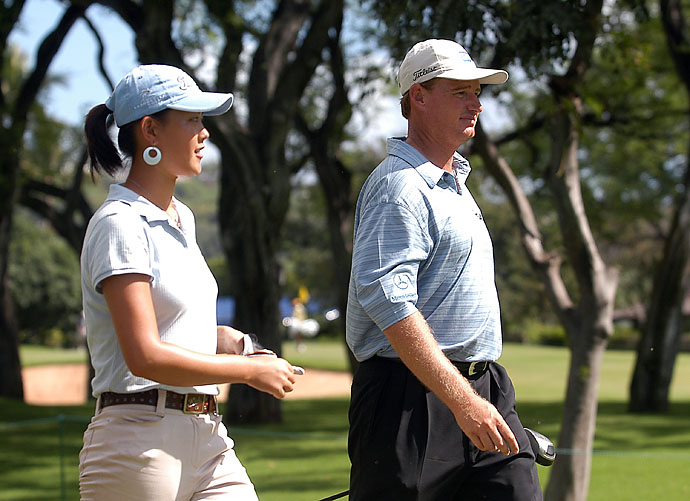 Michelle Wie and Ernie Els during their practice round at the 2004 Sony Open at Waialae Country Club in Honolulu.