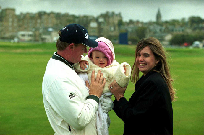 Ernie Els holds his child Samantha along with his wife Liezl after the Pro-Am of the 2000 Alfred Dunhill Cup on the Old Course at St. Andrews, Scotland.