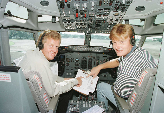 Colin Montgomerie and Ernie Els in the flight deck of the private Boeing 737 jet being used as transport for the Johnnie Walker Super Tour before setting off on the final leg to Bangkok from Manila in November 1996.