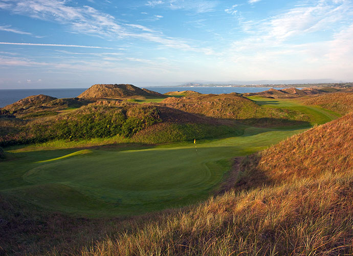 "27. European Club, Brittas Bay, Ireland: Johnny Miller once stated that he'd ""love to see the British Open played here."" For years, Padraig Harrington tuned up his pre-Open links game here -- and twice won Opens a week later. From the tips, the world's 86th ranked course is a rugged test, but the aesthetics match the challenge, thanks to holes that twist through amphitheaters of giant dunes and others that edge the Irish Sea."