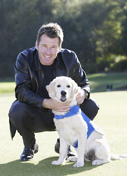 Nick Faldo worked with the Guide Dogs for the Blind charity in 2003.