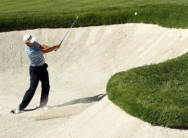 Padraig Harrington bogeyed 18 to finish at four under.