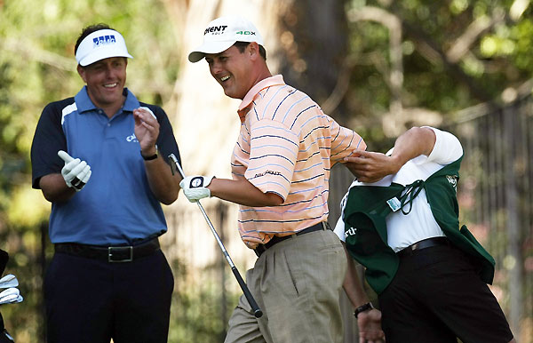 Jeff Quinney, center, celebrated with his caddie, right, after Quinney made a hole-in-one on No. 6.