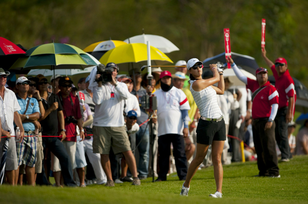Michelle Wie birdied the last two holes to finish one shot off the lead heading into the final round.