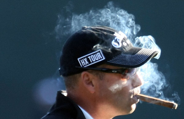 Rocco Mediate enjoyed a cigar while shooting a two-under 69.
