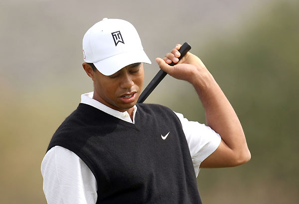 Woods faced J.B. Holmes in the opening match of the WGC-Accenture Match Play Championship. Woods began his round by hitting a drive out of bounds.