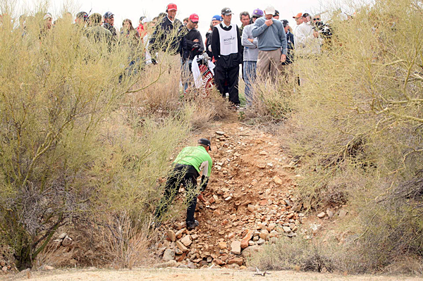 J.B. Holmes made bogey on the 19th hole after driving into the desert.
