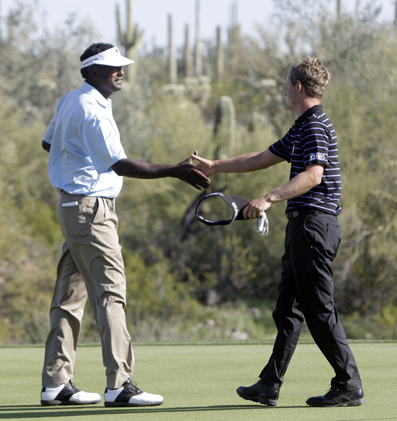 Luke Donald, right, staged a dramatic comeback to beat Vijay Singh in 19 holes.
