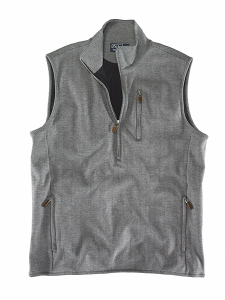Simplicity itself. Beautiful herringbone tweed vest with zippered pockets from Polo Golf by Ralph Lauren, a label golf fans will probably be seeing a lot more of it seems. At the PGA show, the company announced it had signed a five-year deal with the USGA to dress officials and staff at the U.S. Open, and recently Polo-sponsored golfer Davis Love III was named captain of the Ryder Cup team (and, typically, captains choose the clothing).
