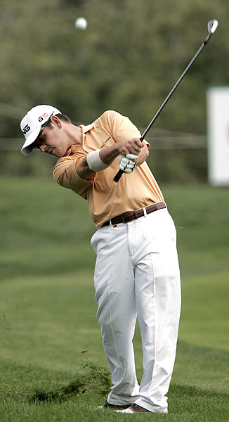South Africa's Louis Oosthuizen shot 65 on Sunday to finish T3 with Els at 12 under par.