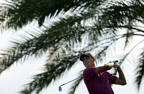 Germany's Martin Kaymer shot a final-round 66 to finish one stroke behind Woods at 13 under par.