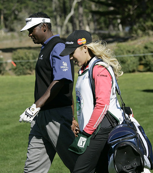Natalie Gulbis, who caddied for Ted Forstmann, the owner of the IMG talent agency, walked with Vijay Singh, who went bogey-bogey-birdie-birdie on the first four holes. Singh is at two under par.